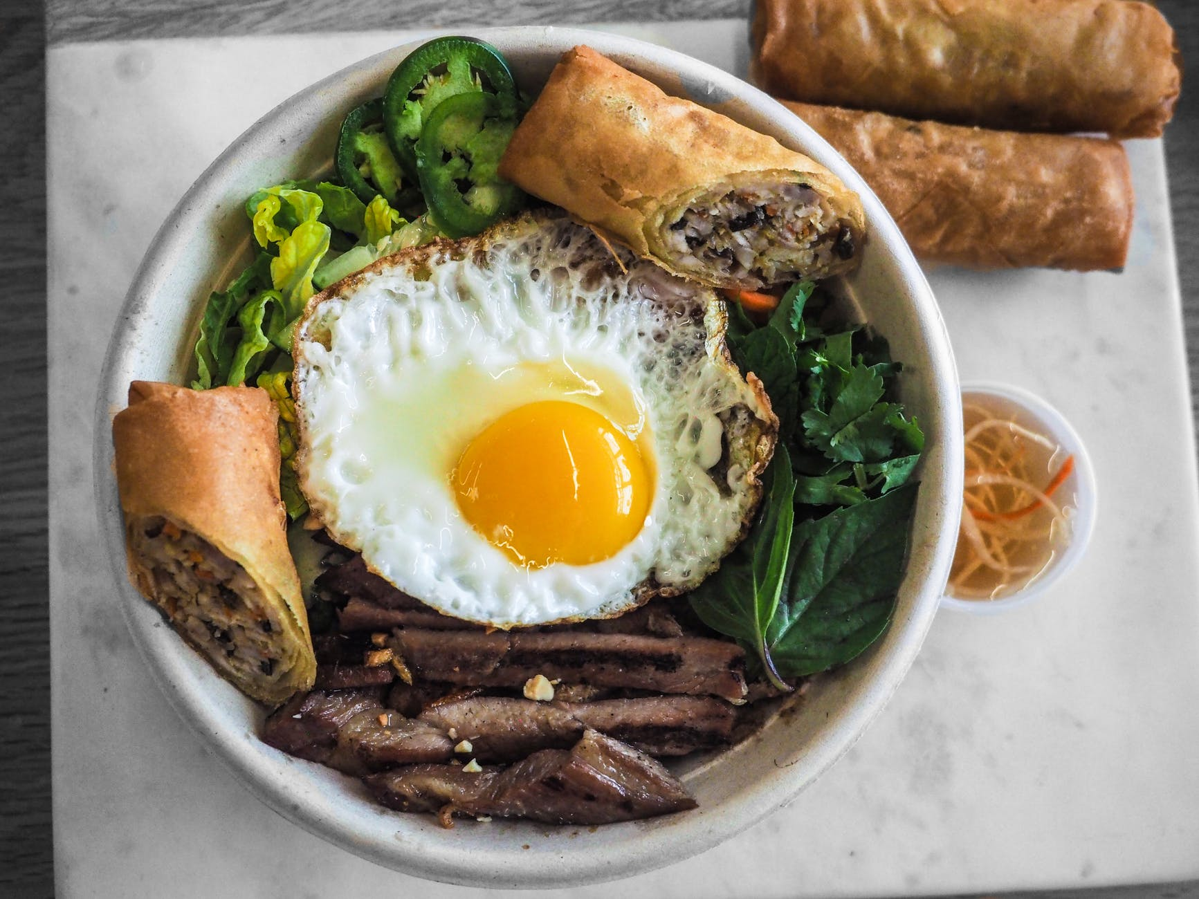 bowl of fried food and fried egg