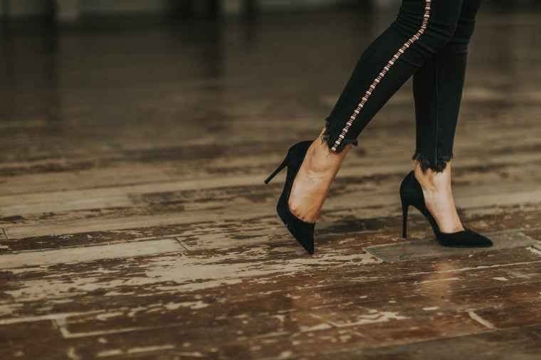woman wearing black suede stilettos